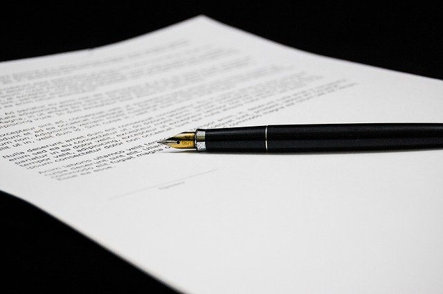 a divorce agreement paper and a pen