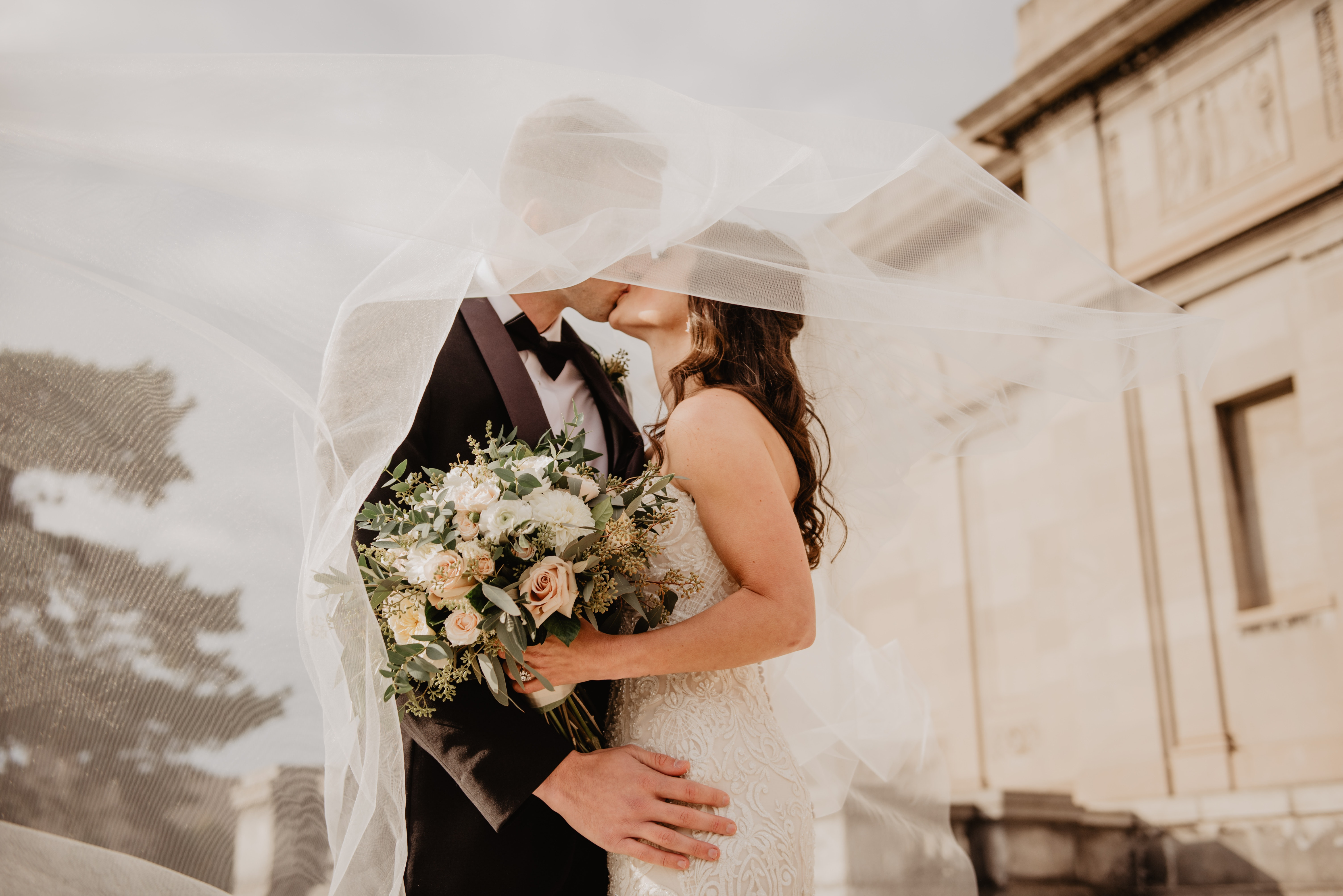 man and woman kissing after wedding