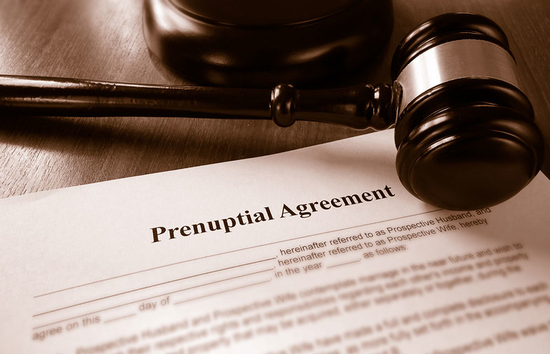 court hammer with prenuptial agreement paper