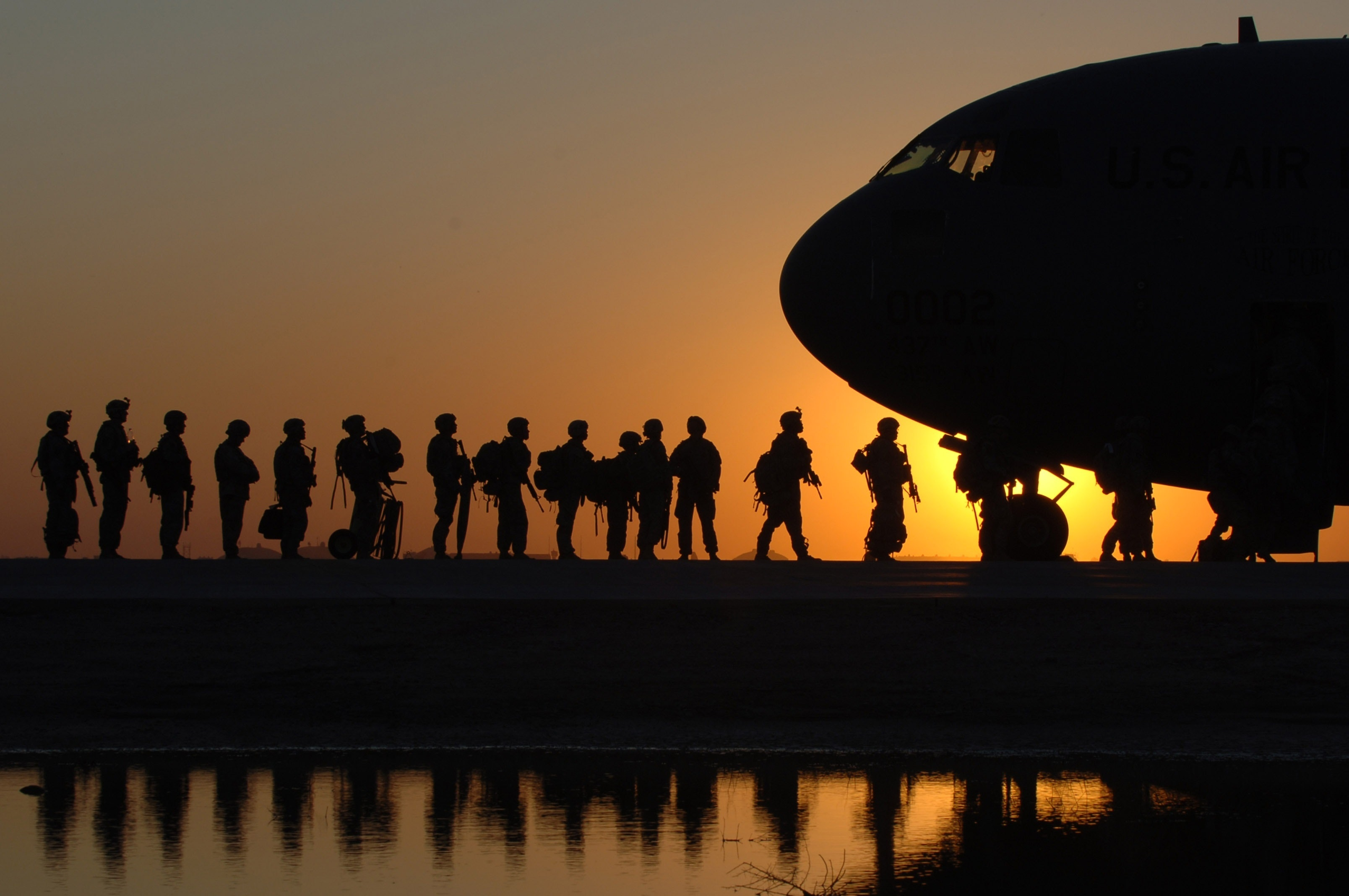 soldiers on cargo plane
